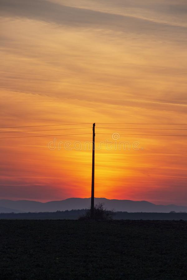 Spectacular sunset over plowed agricultural field royalty free stock photography