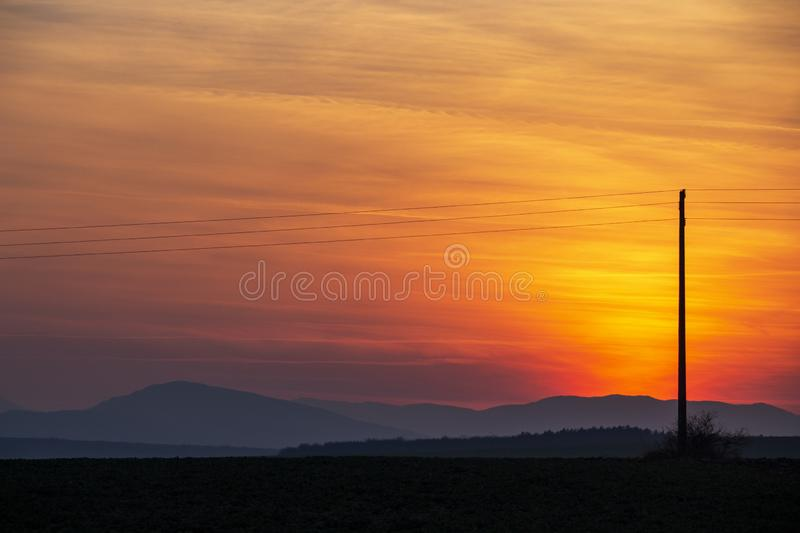 Spectacular sunset over plowed agricultural field royalty free stock image