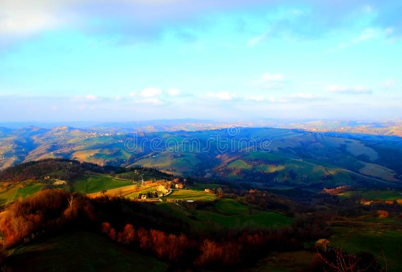 Breathtaking view from above at Marchegian hills. Spectacular view from above at Marchegian hills partly illuminated by sun and partly shaded by clouds royalty free stock photography