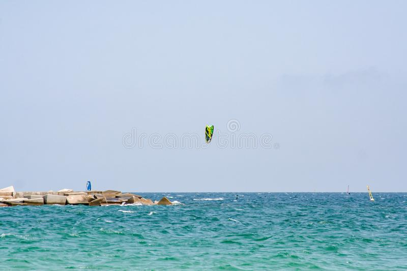 Spectacular view over the sea with kite surfer stock photo
