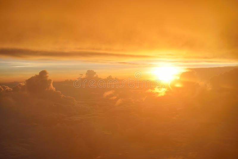 Spectacular view of sunset or sunrise above clouds from airplane window. Top view. Spectacular view of sunset or sunrise above clouds from airplane window stock photos