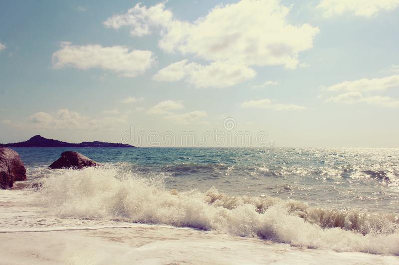 Raging waves roll on the beach stock photos