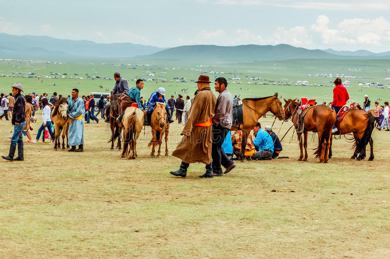 Spectators with horses, Nadaam horse race, Mongolia royalty free stock image