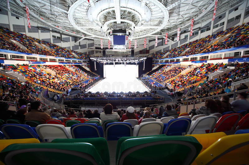 Spectators looks show on rink in Palace of Sports royalty free stock photos