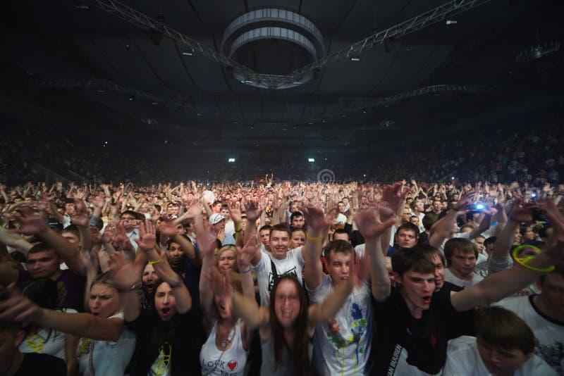 Spectators-participants at Armin van Buuren show. MOSCOW - MAY 7: Spectators-participants at the Armin van Buuren show ARMIN ONLY: MIRAGE, May 7, 2011, Moscow stock image