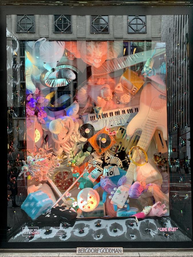 Spectators view holiday window display at Bergdorf Goodman in NYC. stock image