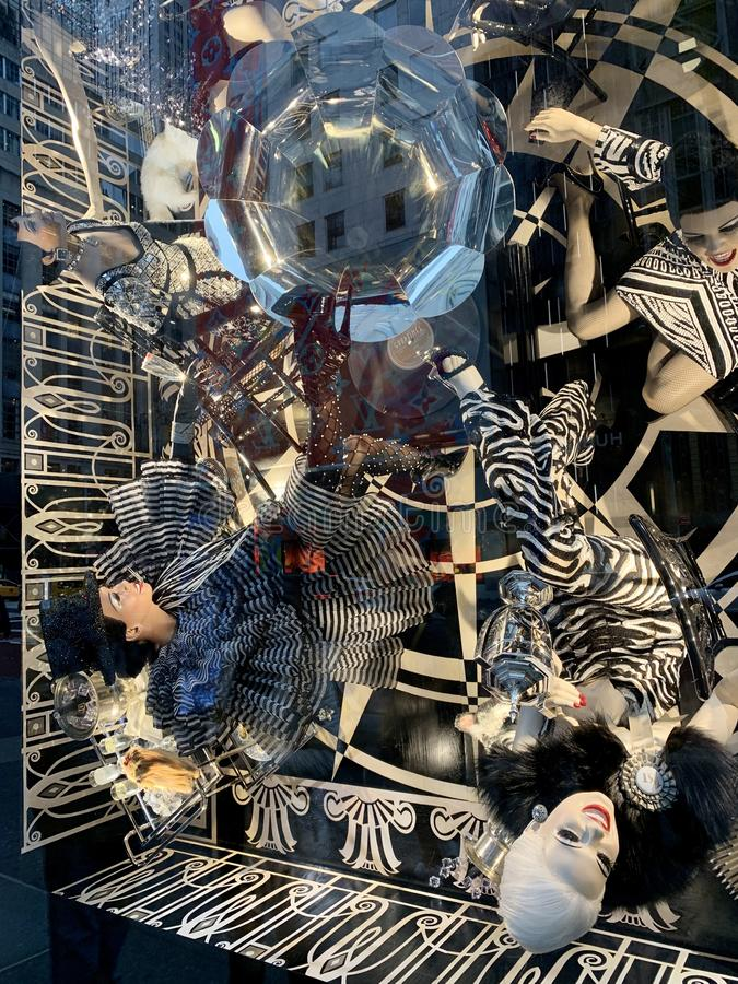 Spectators view holiday window display at Bergdorf Goodman in NYC. royalty free stock images
