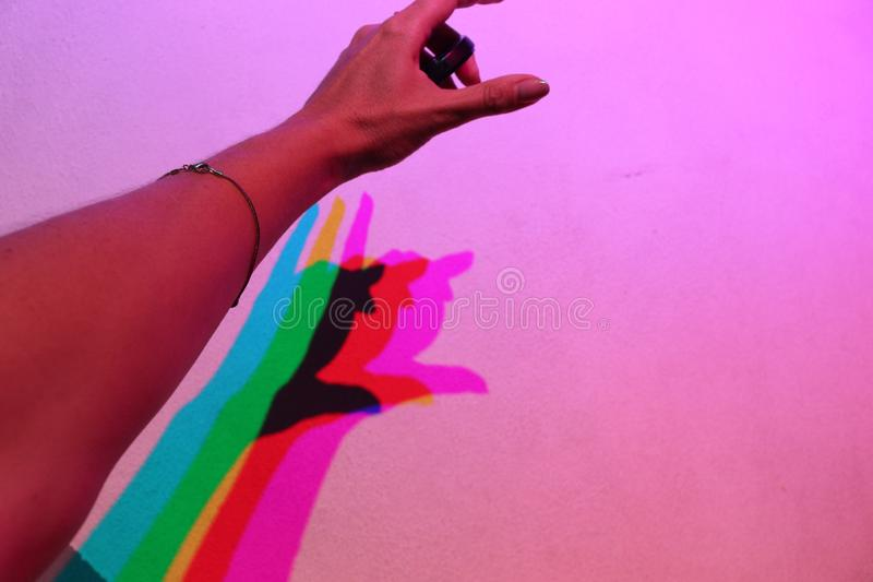 Spectral decomposition of freehand shadow on a pink wall.  royalty free stock photography