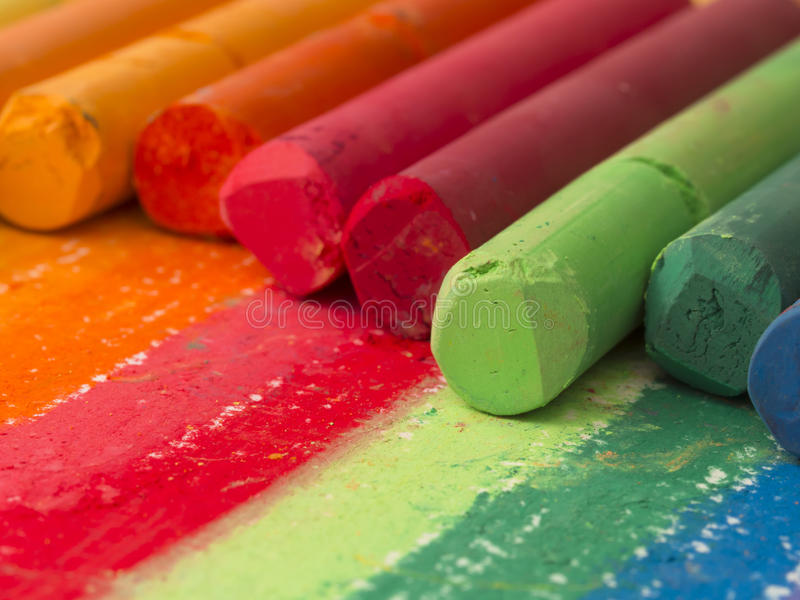 Spectrum of artistic crayons stock photos