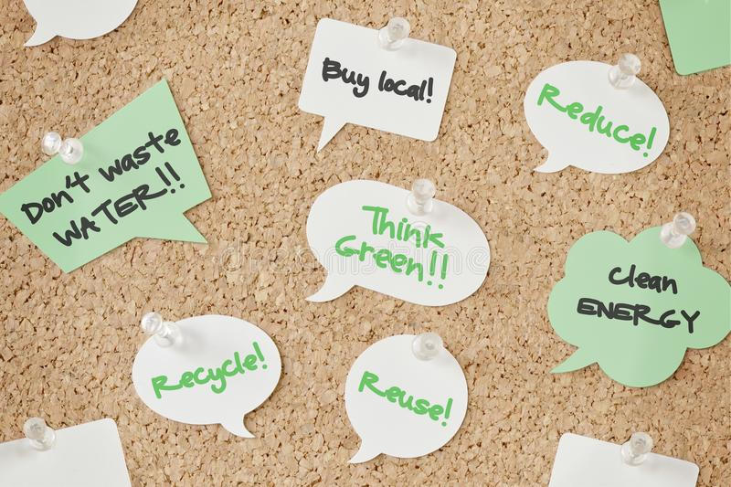 Speech bubbles with eco concept on pinboard. Speech bubbles with ecology messages on pinboard royalty free stock photos