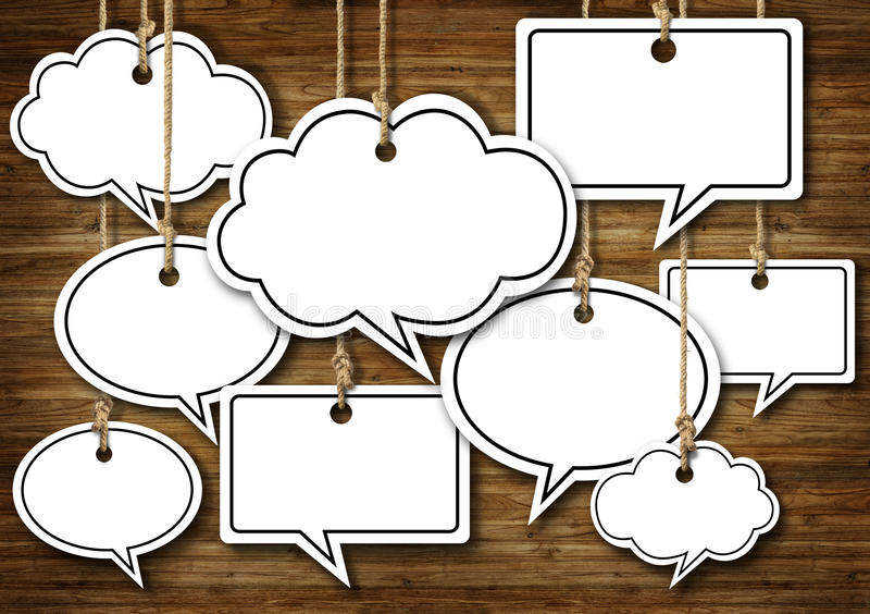 Speech Bubbles Hanging on Wooden Background stock image