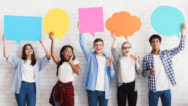 Speech bubbles. Happy friends holding empty placards royalty free stock image