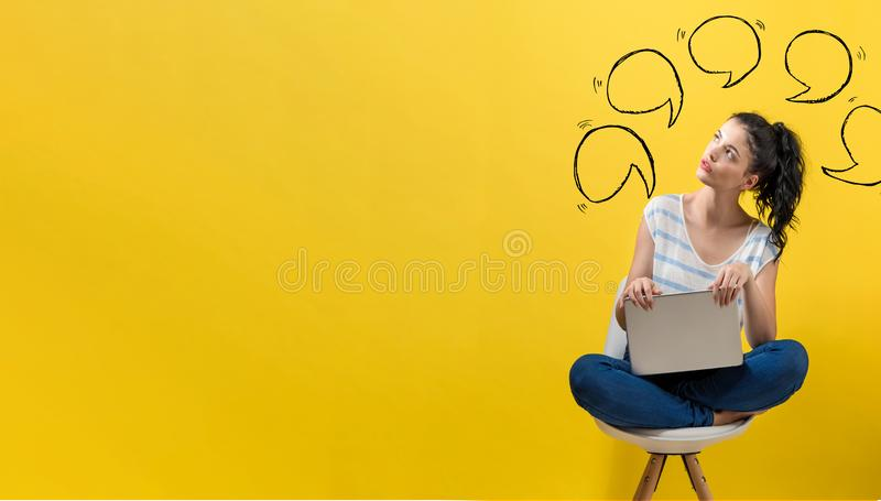 Speech bubbles with woman using a laptop. Speech bubbles with young woman using a laptop computer stock image