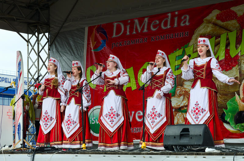 Speech by creative choral collective during Shrovetide celebration. GOMEL, BELARUS - MARCH 12, 2016: Speech by creative choral collective during Shrovetide stock photography