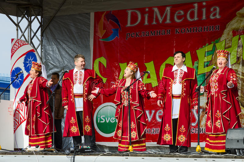 Speech by creative choral collective during Shrovetide celebrations. GOMEL, BELARUS - MARCH 12, 2016: Speech by creative choral collective during Shrovetide stock photos