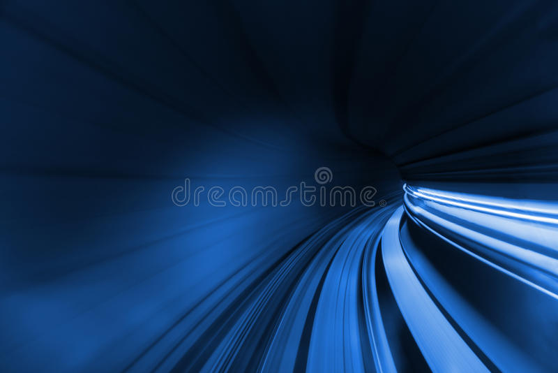 Speed blurred motion of train or subway train moving inside tunnel. stock photography