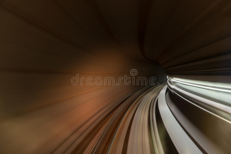 Speed blurred motion of train or subway train moving inside tunnel. stock images