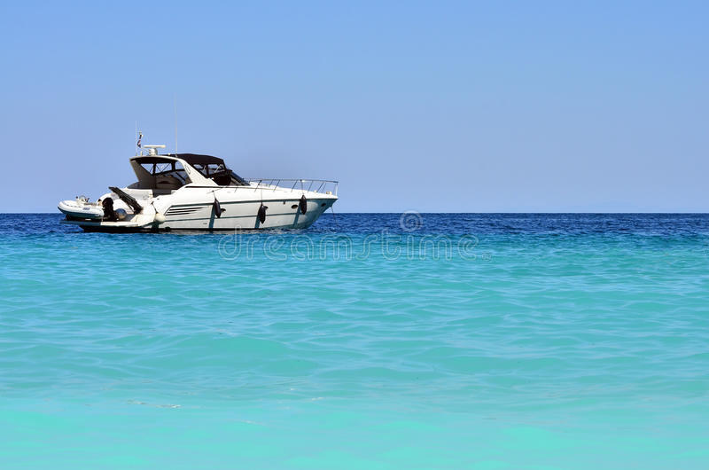 Speed Boat. A luxury speed boat on exotic blue sea stock photo