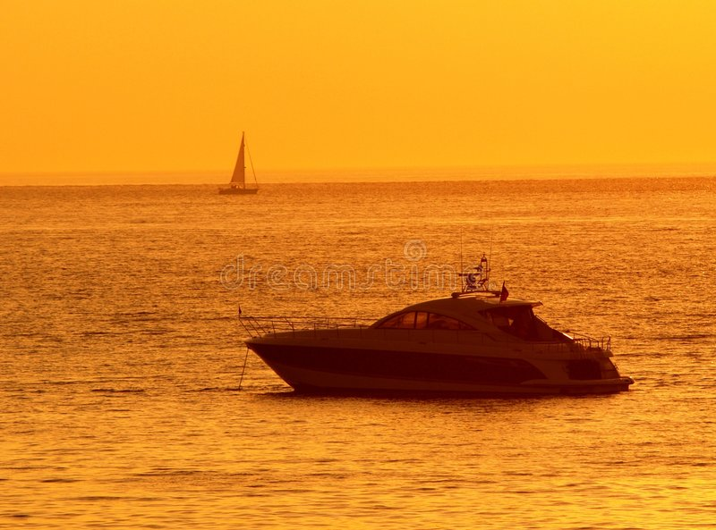 Speed Boat. On sea with the orange glow of sunset stock photo