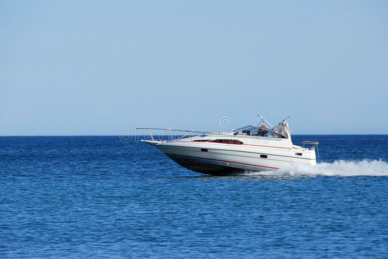 Speed boat. Moving speed boat stock photography
