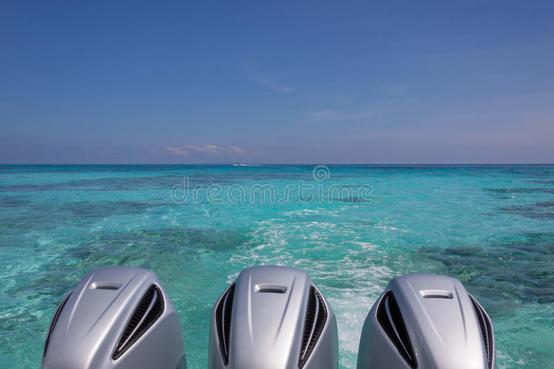Speed Boat Engines. On turquoise sea royalty free stock image