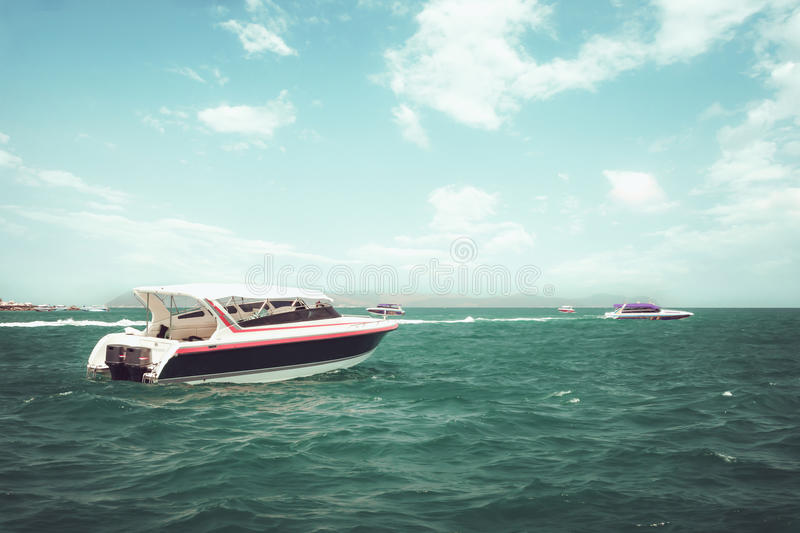 Speed boat. Floating in the ocean in summer. vintage effect color tone royalty free stock image