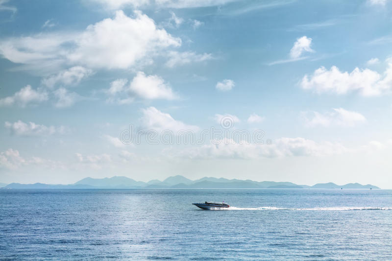 Speed boat moving on blue tropical sea Thailand royalty free stock photos
