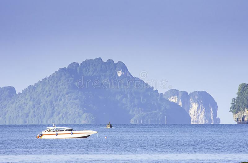Speed Boat in the sea  background Island and clouds on the sky  at Krabi in Thailand.  royalty free stock photography