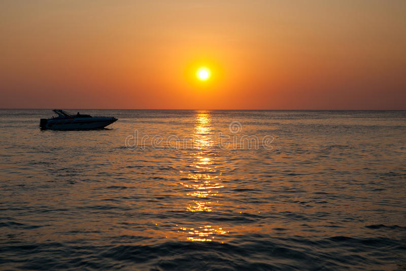 Speed boat in the sea. At sunset royalty free stock images