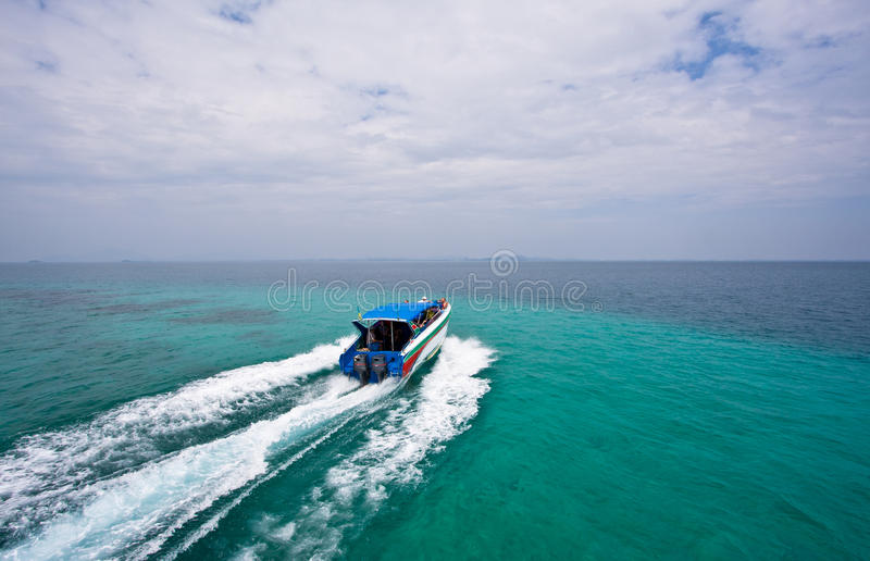 Speed boat in the sea two colors. Two engines speed boat in the sea two colors royalty free stock photography