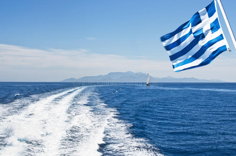 Speed boat traces. On water in the Aegean sea and flag of Greece in motion. Europe stock photos