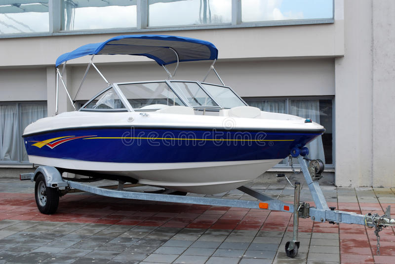 Speed boat on trailer. Ready for transport royalty free stock image