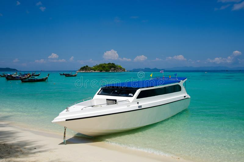 Speed boat on tropical beach, Lipe, Thailand royalty free stock images