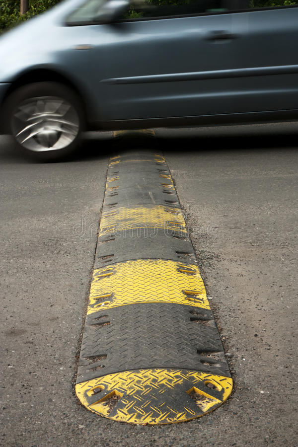 Speed bump. On a road when a car is passing stock photos