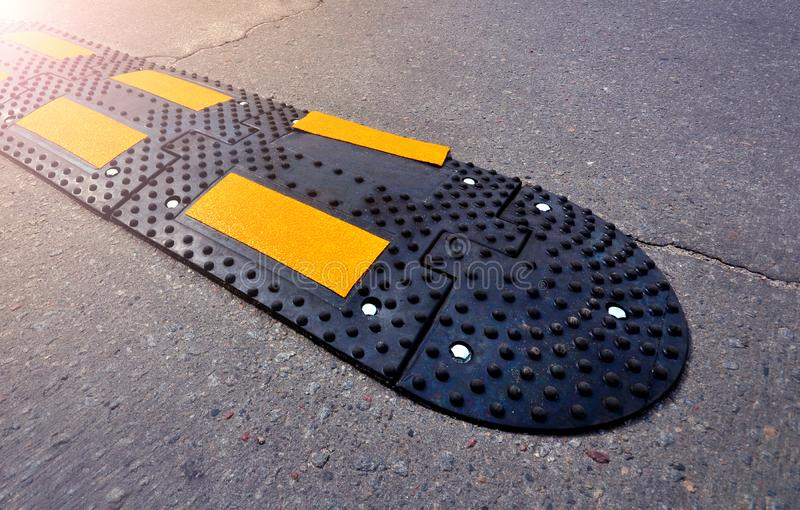 Speed bump close-up on asphalt road stock photography