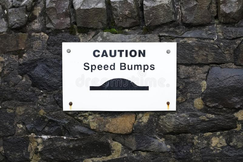Speed bumps road safety sign stock photography