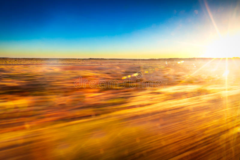 Speed and fast movement with Australian outback as background. Speed and fast movement with hot Australian outback as background stock images