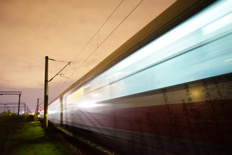 Speed forward destination. Night train passing in high speed in Carpati station Bucharest Romania. Journey by train royalty free stock photography