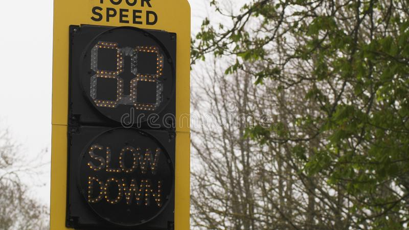 Speed indicator display activated by vehicles passing and flashing your speed slow down stock photo