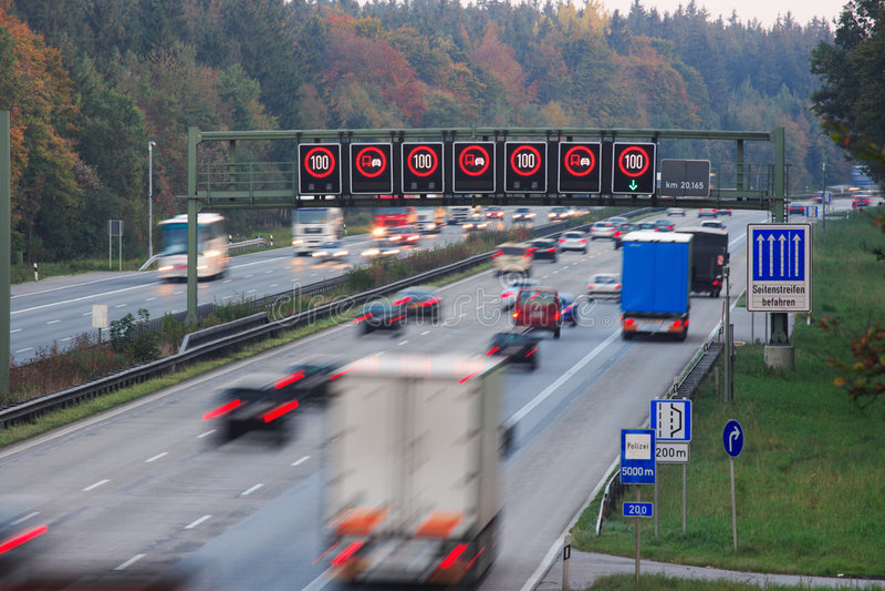 Speed limit. And evening traffic on German autobahn stock photos