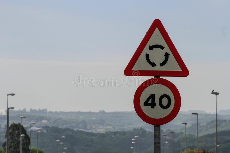 Speed limit in the city. Circulation signs in the city, both speed and arrival at a roundabout which limits the speed stock photo
