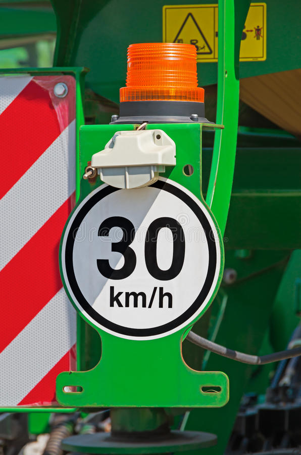 Speed limit. Illuminated signal speed limit posted on back of tractor royalty free stock photos