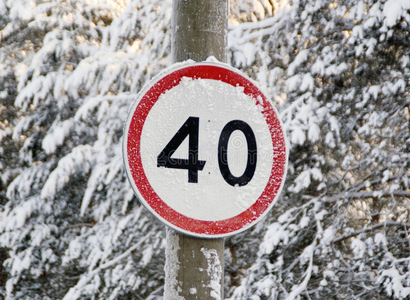 Speed Limit Sign On A Forest Road Royalty Free Stock Photography