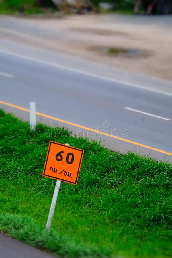 Speed limit sign with a traffic in the background.  stock photo