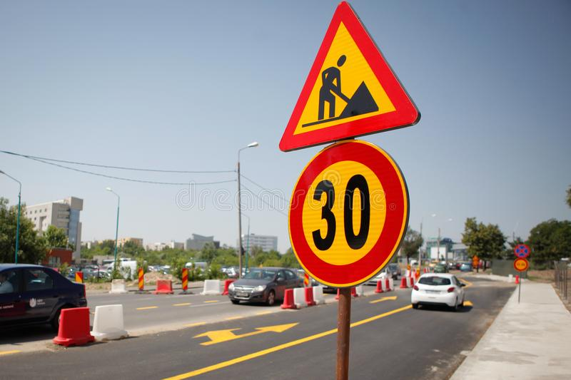 Speed limit and work in progress road signs royalty free stock photo