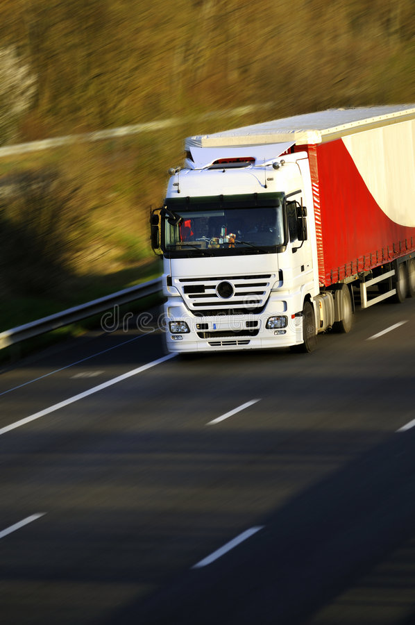 Speed logistic. The truck goes quickly. speed on the highway stock photo