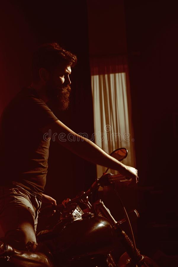 Speed masters. beat speed masters with motorcycle. one of speed masters has long beard. man hipster best of speed. Masters. nothing comes between him and his stock image