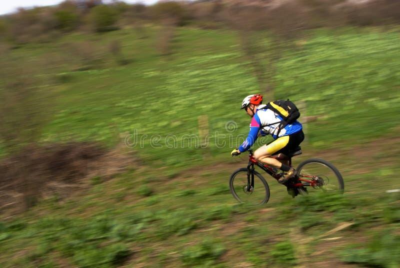 Speed motion mountain biker royalty free stock image