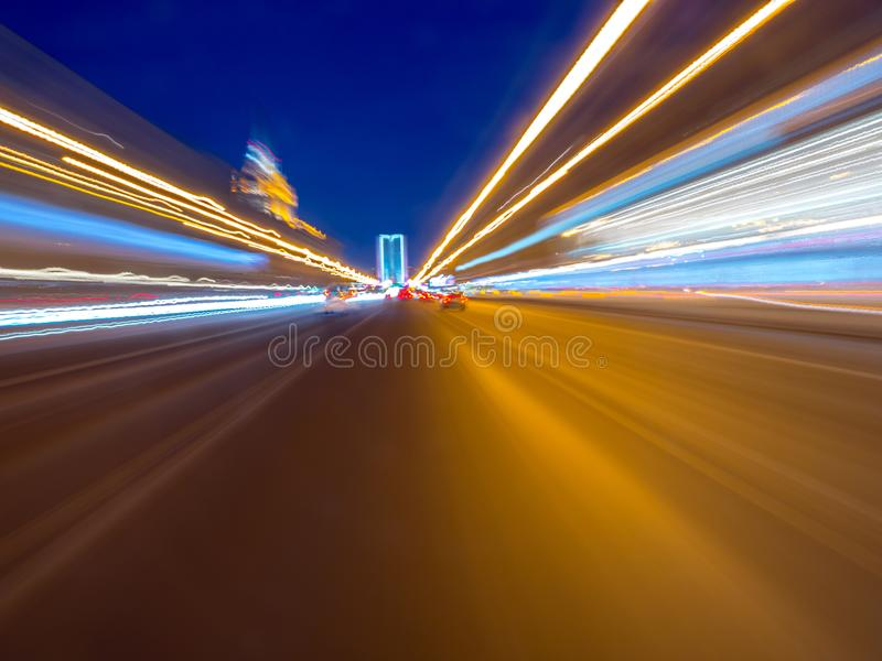 Speed motion on the neon glowing road at dark. stock image