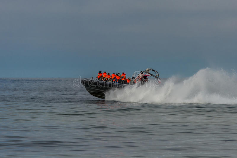 Speed motor boat transporting people on sea.  stock image